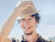 Hipster guy smiling. Cool hipster guy in the hat Royalty Free Stock Image