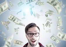 Hipster guy under dollar rain Royalty Free Stock Photo