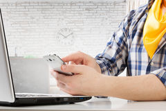 Hipster guy use laptop . Mixed media Royalty Free Stock Images