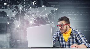 Hipster guy use laptop Stock Image