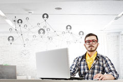 Hipster guy use laptop Stock Images