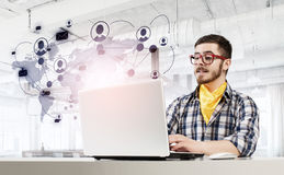 Hipster guy use laptop Stock Photos