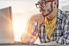 Hipster guy use laptop Royalty Free Stock Images