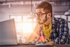 Hipster guy use laptop Royalty Free Stock Photo