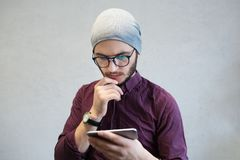 Hipster guy using smarphone on background of white. royalty free stock images