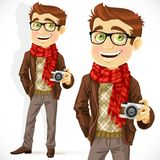 Hipster guy wearing a scarf and with a camera Royalty Free Stock Photography