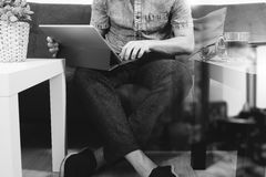 Hipster hand using digital tablet docking keyboard,holding cradi Royalty Free Stock Images