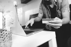 hipster hand using laptop compter,holding cradit card payments o Stock Photo