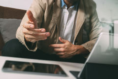 Hipster hand using smart phone,digital tablet docking keyboard,c Stock Photography