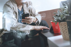Hipster hand using smart phone,digital tablet docking keyboard,c Royalty Free Stock Photography