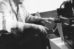 Hipster hand using smart phone,digital tablet docking keyboard,c Royalty Free Stock Photo
