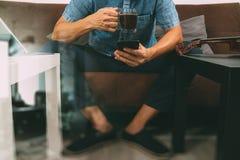 Hipster hand using smart phone,digital tablet docking keyboard,c Royalty Free Stock Image