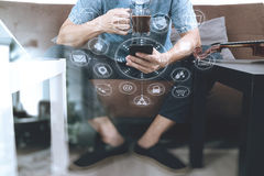 Hipster hand using smart phone,digital tablet docking keyboard,c. Offee cup, payments online business,sitting on sofa in living room,work at home concept,virtual Royalty Free Stock Image