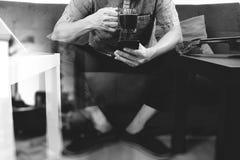 Hipster hand using smart phone,digital tablet docking keyboard,c Royalty Free Stock Images