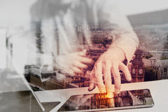 Hipster hand using smart phone,digital tablet docking keyboard,c. Double exposure,hipster hand using smart phone,digital tablet docking keyboard,coffee cup Royalty Free Stock Photos