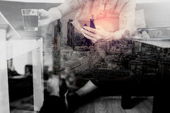 Hipster hand using smart phone,digital tablet docking keyboard,c Royalty Free Stock Photos