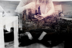 Hipster hand using smart phone,digital tablet docking keyboard,c Stock Images