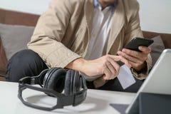 Hipster hand using smart phone,digital tablet docking keyboard,h Stock Image