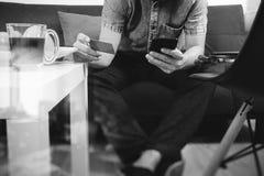 Hipster hand using smart phone,digital tablet docking keyboard,h Stock Photos