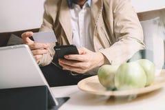 Hipster hand using smart phone,digital tablet docking keyboard,h Royalty Free Stock Photos