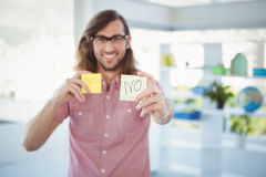 Hipster holding adhesive note with no sign Stock Image