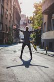 Hipster holding arms wide open in the street stock photos