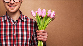 Hipster holding a bouquet Royalty Free Stock Photos