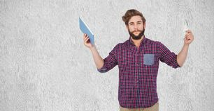 Hipster holding money and tablet PC. Digital composite of Hipster holding money and tablet PC royalty free stock photos