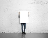 Hipster holding poster Royalty Free Stock Photography