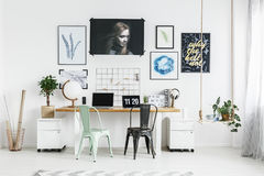 Hipster home office. In white with big double desk stock images