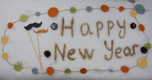 Hipster inscription Happy New Year written on the snow Stock Photos