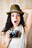 Hipster jaw dropped woman with camera Royalty Free Stock Photography