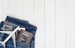 Hipster Jean pant with travel objects on white. Wooden copy space Royalty Free Stock Photo