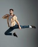 Hipster jumping man Stock Photos