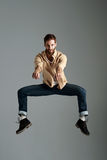Hipster jumping man Stock Photography