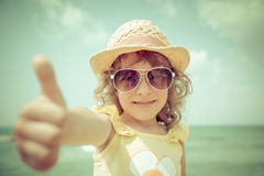 Hipster kid at the beach Stock Image