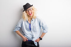 Hipster leaning against the wall Royalty Free Stock Photo