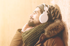 Hipster listening music with headphones in warm tones style Royalty Free Stock Photography