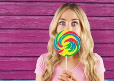 Hipster  with lollipop with pink wood background Stock Photos