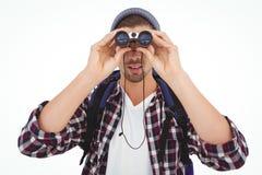 Hipster looking through binoculars Royalty Free Stock Image