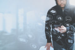 Hipster male in a hood hand using mobile phone payments online s. Hopping,omni channel,front view,icons graphic virtual interface screen,eyeglass Royalty Free Stock Images
