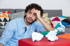 Hipster male student with problems. During learning at home Royalty Free Stock Images