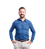 Hipster man in blue shirt, studio shot, isolated Stock Photography