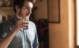 Hipster man drinking a glass of coke Stock Image