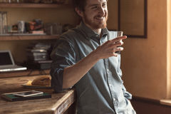 Hipster man drinking a glass of coke Stock Photography