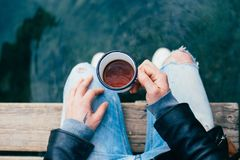 Hipster man drinks coffee on camping trip Stock Photography