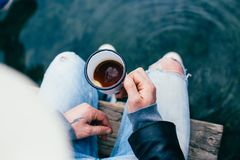 Hipster man drinks coffee on camping trip Royalty Free Stock Photos