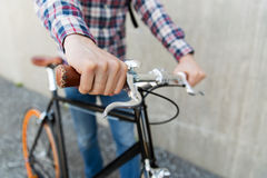 Hipster man with fixed gear bike and backpack Royalty Free Stock Photos
