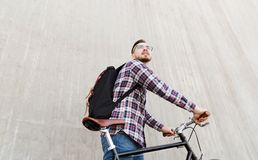 Hipster man with fixed gear bike and backpack Royalty Free Stock Image