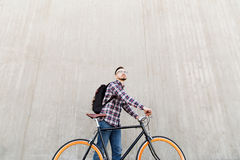Hipster man with fixed gear bike and backpack Stock Images